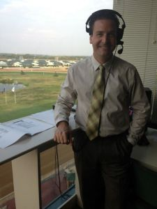 John Lies in his booth at Lone Star Park in Dallas